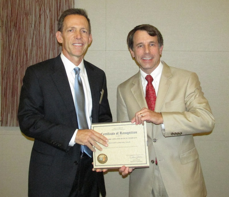 Kirk Kniss accepting a Leadership Award from the Commissioner on behalf of New York Life for the greatest percent increase in COIN qualified holdings from 2009 to 2012.