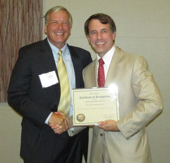 Jerry Baier accepting a Leadership Award from the Commissioner on behalf of Northwestern Mutual for holding the most High Impact COIN Qualified Investments in 2012.